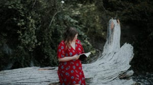 young-woman-outside-reading-bible-brokenhearted-and-mad-at-god-struggling-to-love-god