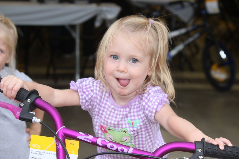 Image features a young REC member riding the youth bicycle she won at our 2016 annual meeting