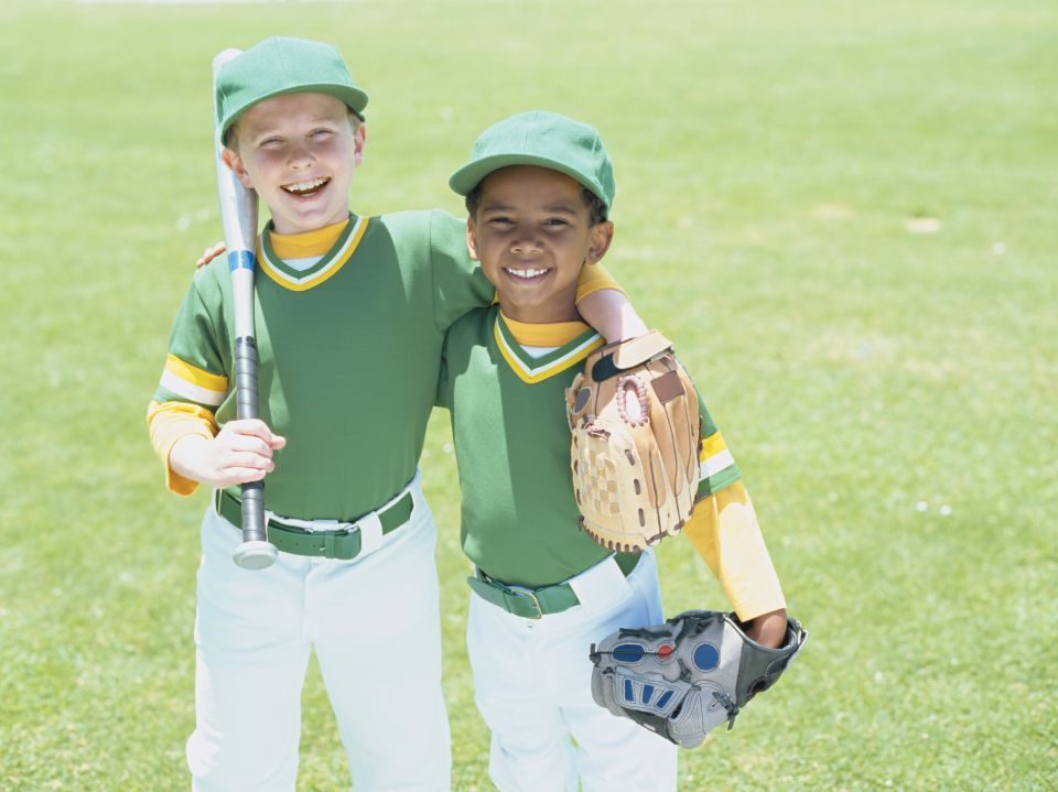 image features two boys in baseball uniforms