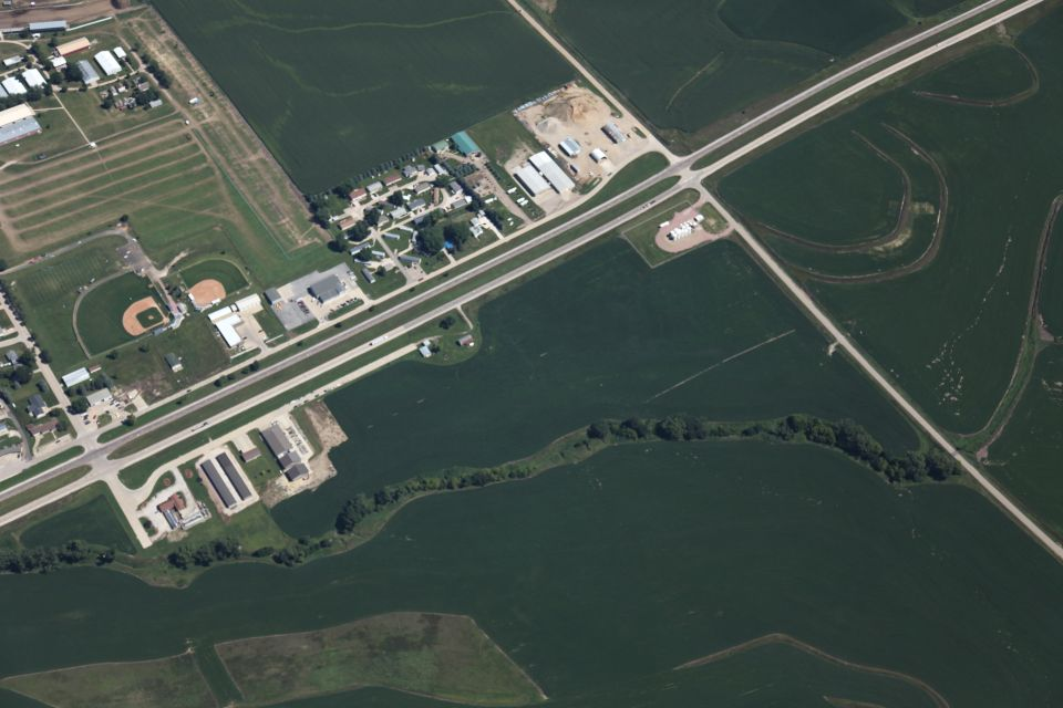 Image features an aerial photo of a development site in Woodbury County