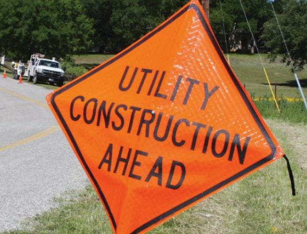image features a road construction CAUTION sign