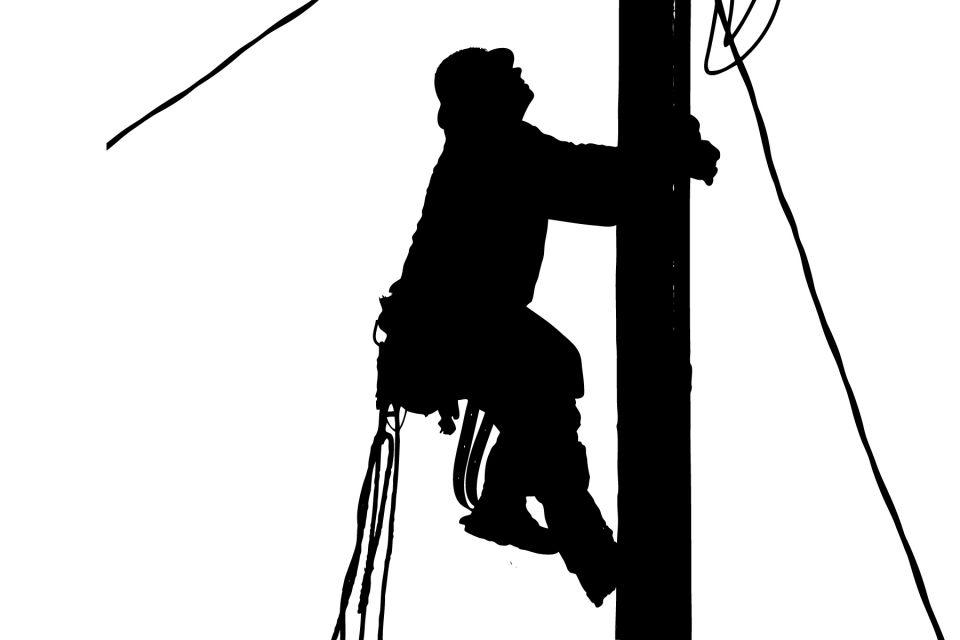 Image features a lineman climbing to the top of a power pole.