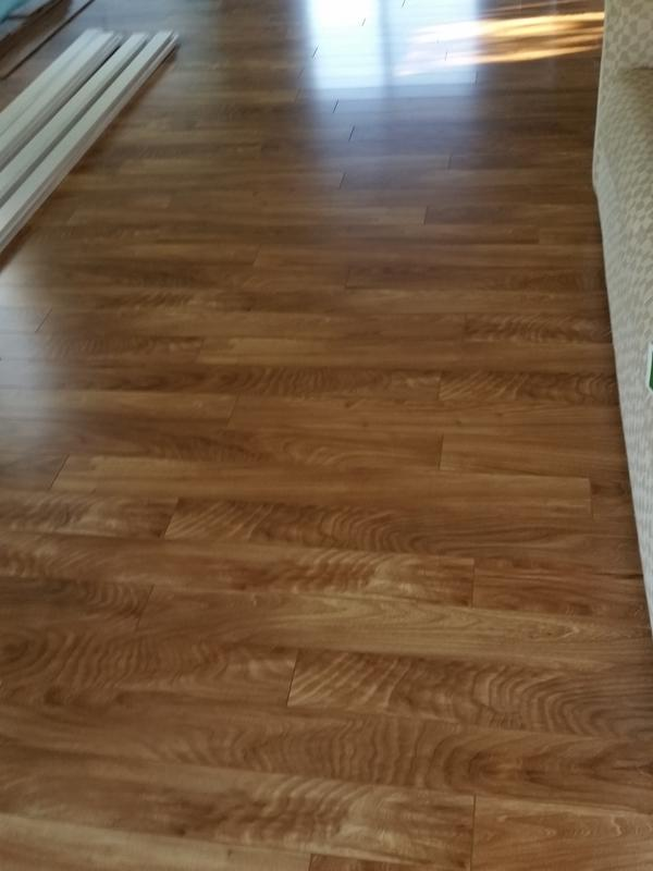 Before and after image for 10mm+pad Madison River Elm Laminate