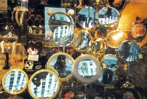 Betsy Barone | Bruce and many mirrors in a window on Madison Avenue in New York City | New York
