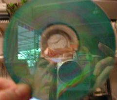 Helen McClary | Reflection in CD with clock in middle | Ft. Lauderdale, Florida, USA