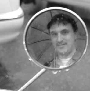 Mike Clarke | Tokyo scooter mirror in the rain | Tokyo