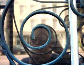 Jay Cotton   wrought iron spiral with my reflection   Charleston, SC