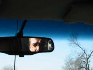 Brian | rearview mirror | Somewhere on a highway.