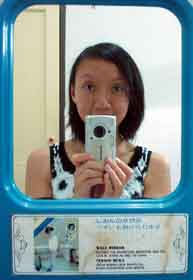 hweeling   woman in mirror in mirror with woman   taiping, malaysia