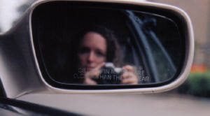 Kelly Simbirdi | Objects Are Closer Than They Appear | In the car, driving thru San Francisco
