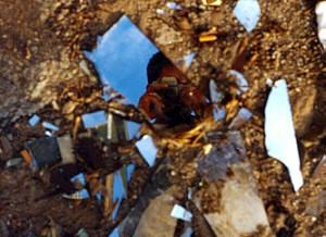 Pau | Broken mirror on the roadside | vinar�s, spain
