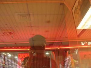 Regina De Rozario | Backed by red neon | Collyer Quay, Singapore