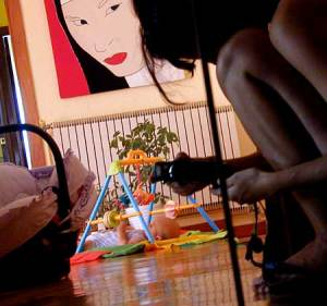 Uma B. | Self portrait with playing baby | San Lorenzo del Escorial (Madrid) Spain