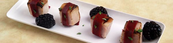 Blackberry-Peach Wrapped Pork  Recipe image