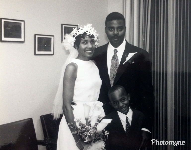 Our wedding day. Teresa and Alandis Hicks (we were 30 somethings) of Norfolk, VA. The little boy is our son Narada Xavier Hicks who is now 27.  I was going though a black and white photography phase and a friend took the picture using my camera. USA 1996. Shared by Teresa Hicks
