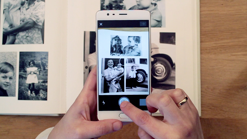 You can scan up to 3-4 paper photos in a single shot
