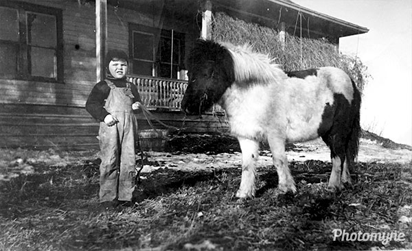 Daddy (age 6) and his horse Ruby at the old house. Canada 1937