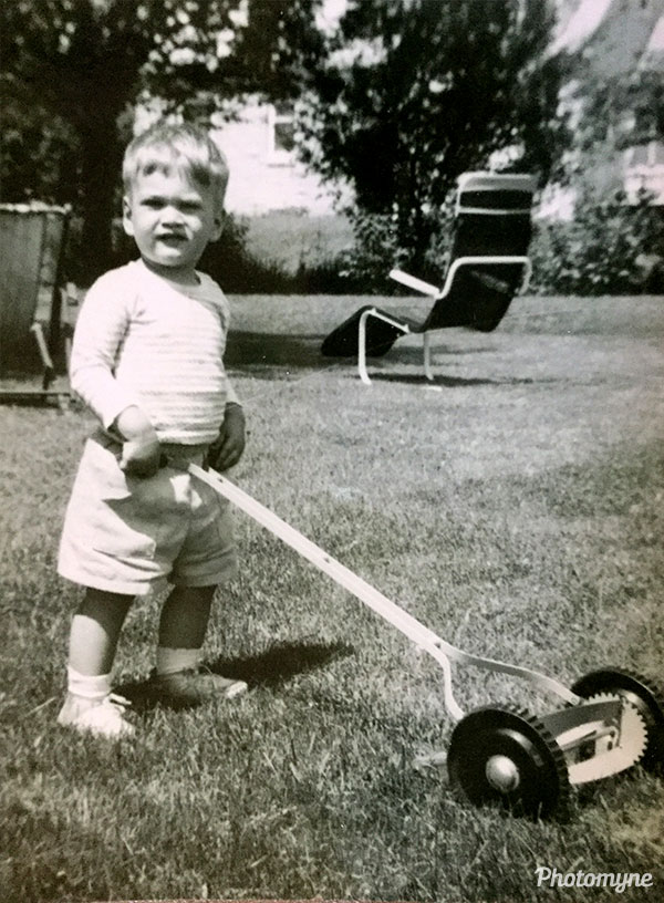 My brother Jeff about 3 years old with his push lawnmower. USA 1955
