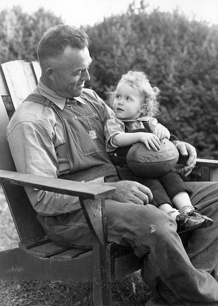 Sitting on Dad's lap, a timeless tradition. Via Creative Commons