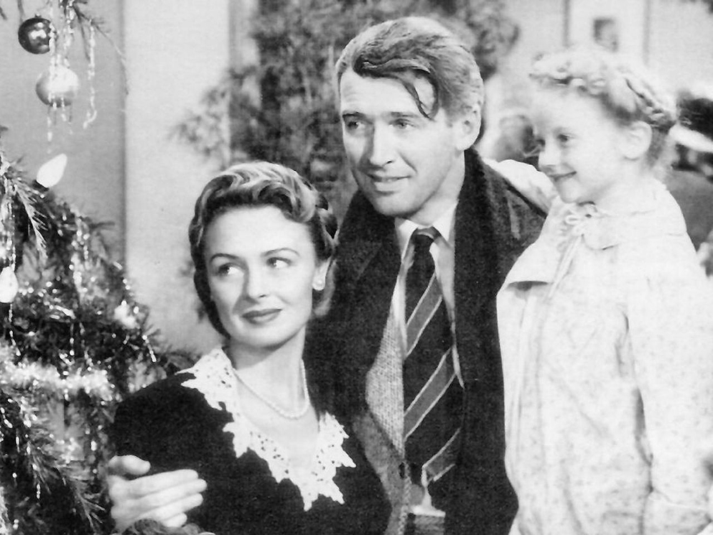 It's a Wonderful Life still with Jimmy Stewart, Donna Reed, and Karolyn Grimes - photo via Wikimedia Commons