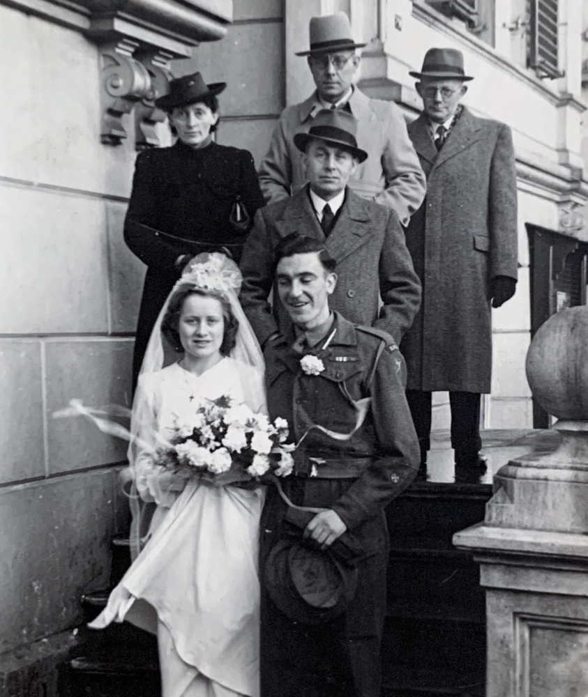 Outside town hall on their wedding day