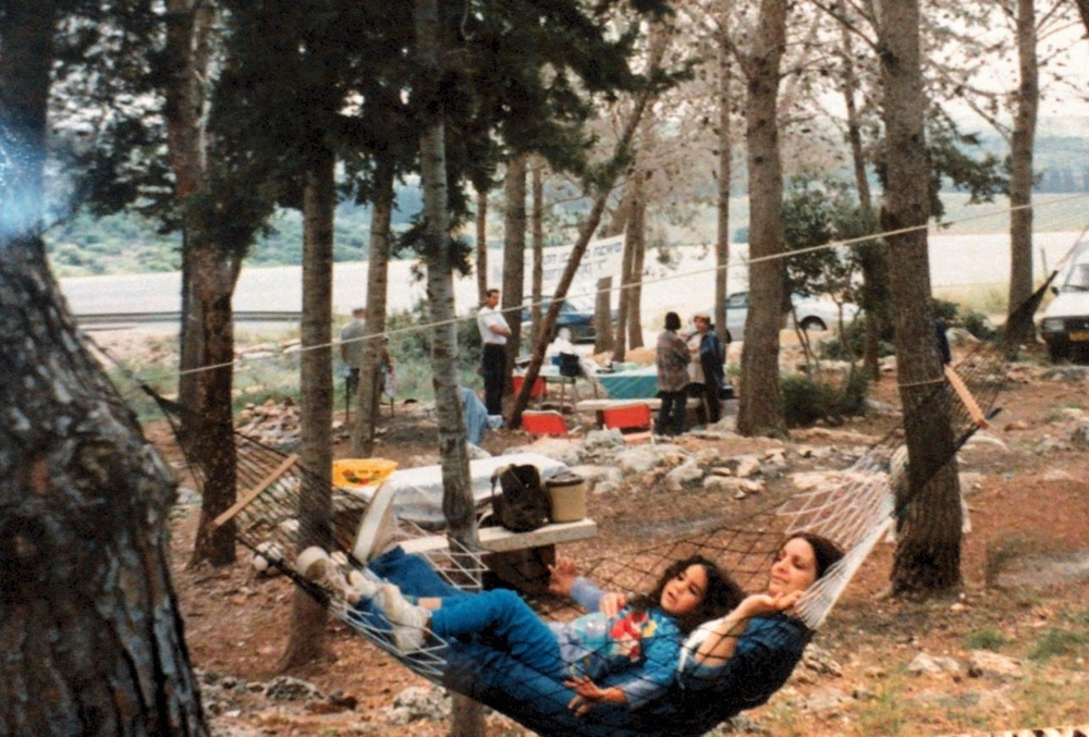 Nery Huber, QA Manager - Getting some rest with mom after the Independence Day celebration (Kabri Forest, 1999).