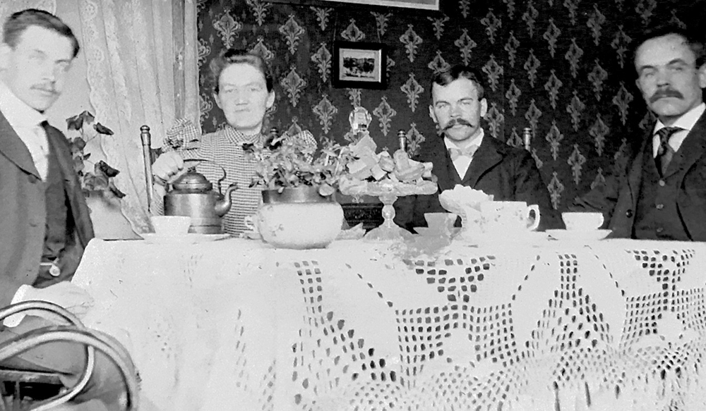 Elisabet's grandparents having coffee with two lodgers in their house in Plainfield NJ in 1899.  She has the small picture hanging on their wall hanging in her own office.