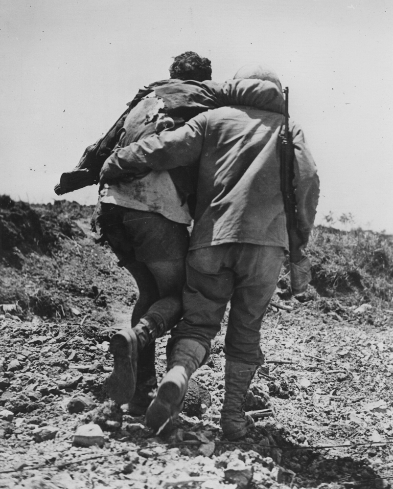 Helping an injured brother on the battlefield. Via Creative Commons