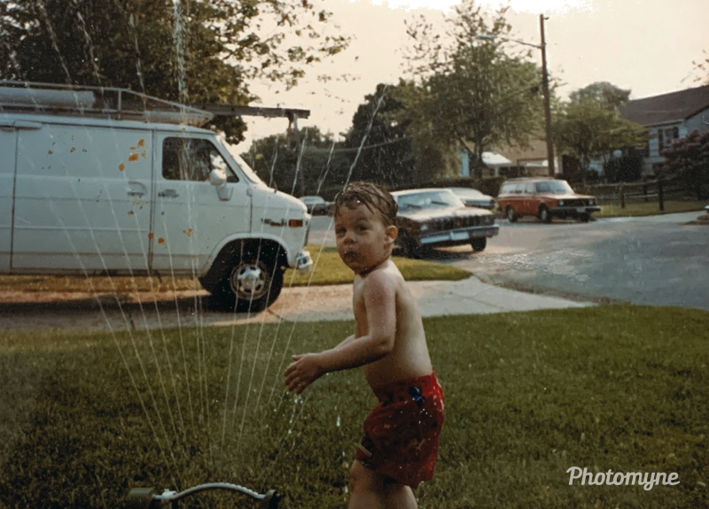 Cooling off with a sprinkler. Brentwood, NY, USA - July 15, 1987. Shared by Bill Powers