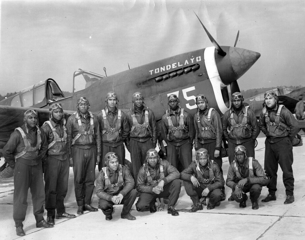 Tuskegee Airmen before taking to the skies. Via Wikimedia Commons