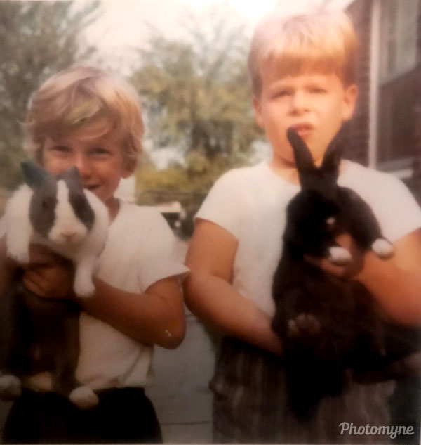 Two scaredy cats holding rabbits. USA 1970
