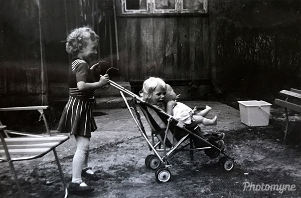 Girls while playing in the garden. Poland 1981