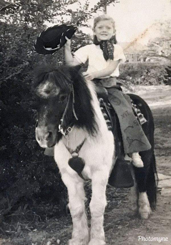 Photographers walked neighborhoods to earn money by taking kids pictures on the horse. USA 1953