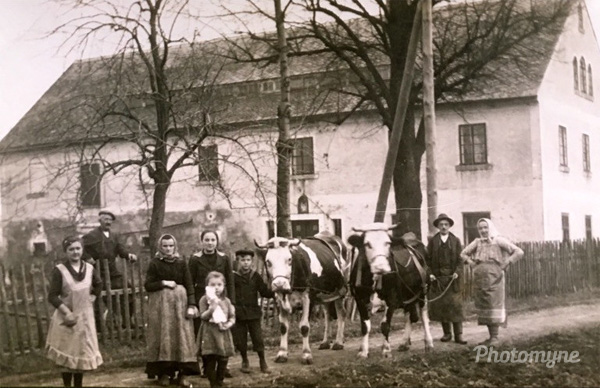 My Grandma, left, with her family on the way to work on the farm fields. Bukovec (Isergebirge), Czech Republic, 1918