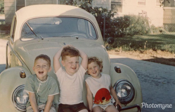 That's me in the middle, Tim on the left, and Jill (Tim's sister) on the right. Sitting on one of Uncle Jack's VW Bugs. Found this photo in one of mother's boxes of pictures. MI, USA 1967