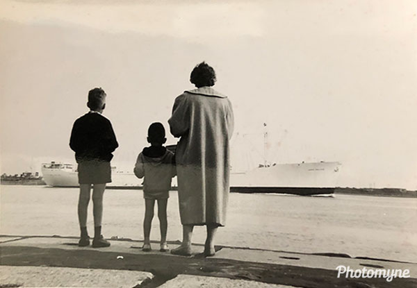 From the left: My brother Peter, me (Cees van der Wel) and my mother Lenie. I'm six years old here. Photo taken by my father Piet, a truck-driving man and a working class hero. The location is at a pier in the coastal city of Hoek van Holland, west of Rotterdam. It's where we spent our holidays. I remember I used to daydream there as a kid. I used to imagine the ships leaving the harbor and taking over the world, and how I, too, would one day discover the rest of the globe. And that's what I ended up doing as a television reporter. Today, at 67 years old I'm the only one left. Finding this long forgotten picture touched me. Not only because of the loss of my family, but because of my father's eye of a photographer. The Netherlands 1950s