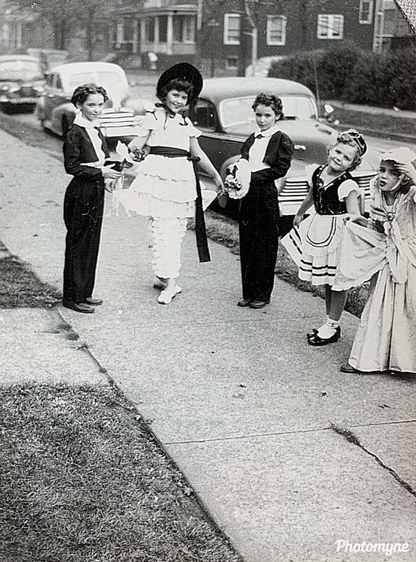 My mom is in the Little Bo Peep outfit. She and her sisters (twins) used to put on shows in the backyard. MI, USA 1946