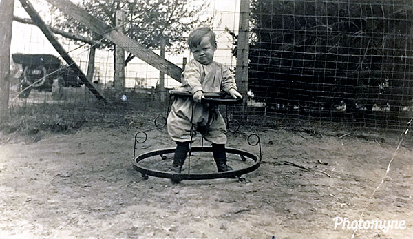Grandma in her baby walker. I did not realize that there existed baby walkers over 110 years ago. Location unknown 1913