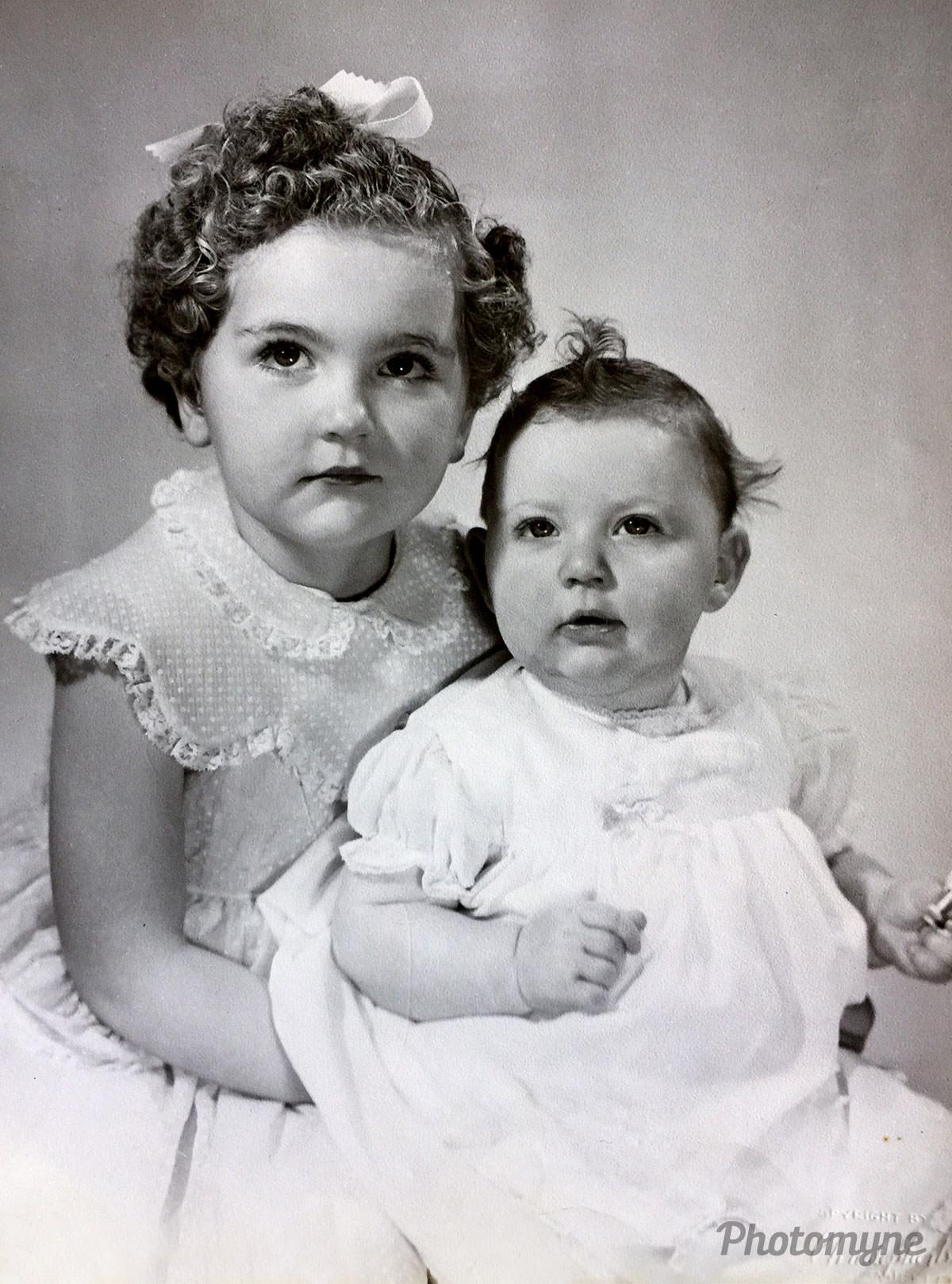 Cute pic of two sisters, Te Anau, New Zealand, 1957