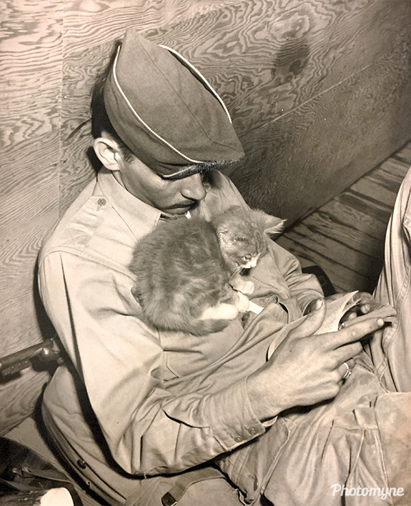 Dad and a kitten. USA (year unknown)