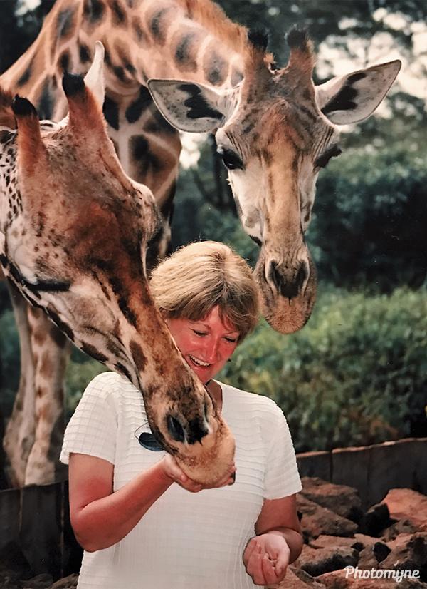 Mel feeding the giraffes. Kenya 2003