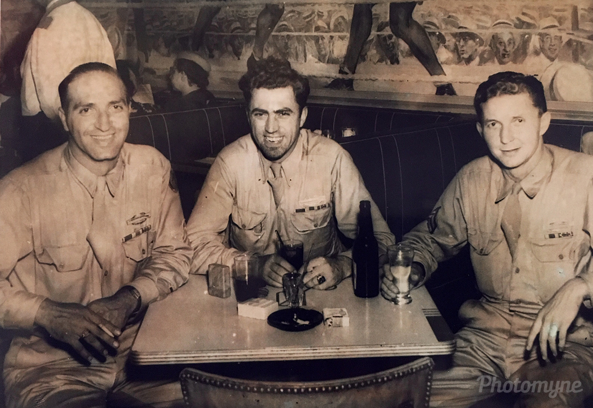 Three of the greatest generation celebrate coming home. When this was taken the soldier in the middle had no idea that his brother was going to marry the soldier on the right's sister, and visa versa. New York, USA 1945