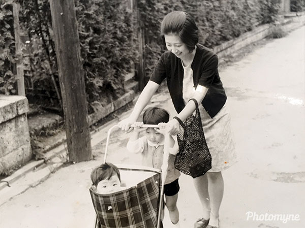 Here I am with my 1 year-old brother. My mom used to put me in this shopping cart for fun. We did not have a car back then. This is actually my very first memory. I remember the edges of the shopping cart and looking outside. Tokyo, Japan 1969