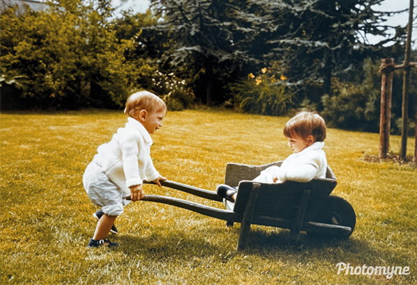 CThe twins playing in the garden. They understand each other. Germany 1981