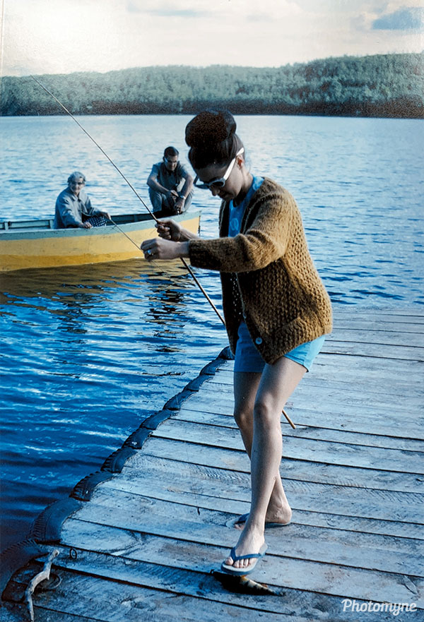 Mena fishing for perch at Lake Kipabiskau. Canada 1966