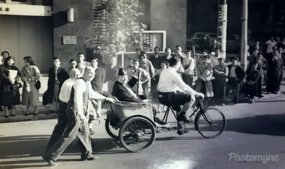 Around 1950 in Tokyo, my father in his Mason outfit on a pedicab