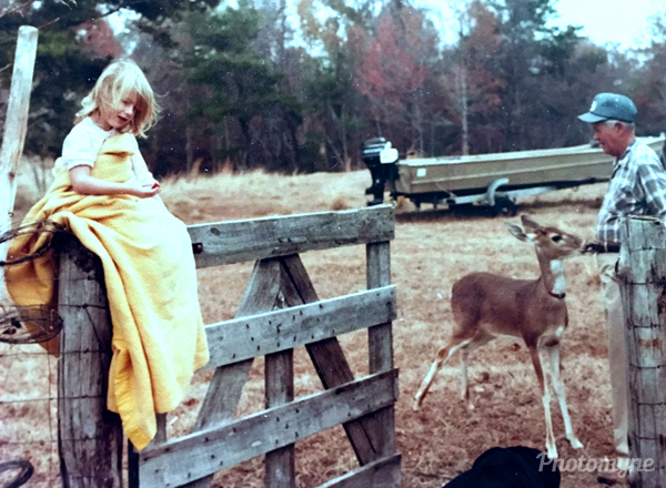 Fall season reminds me of Daddy. This picture was taken about 1980 with Daddy feeding Bucky while granddaughter, Kelly, is snuggled up on the fence post. This picture says so many things to me, but mostly love. Florida, USA 1980