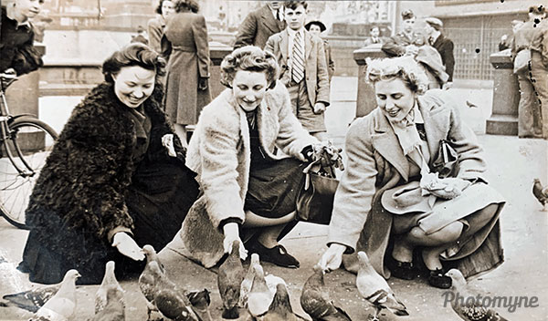 My Nan in London feeding the pigeons looking fabulous. Great Britain 1940