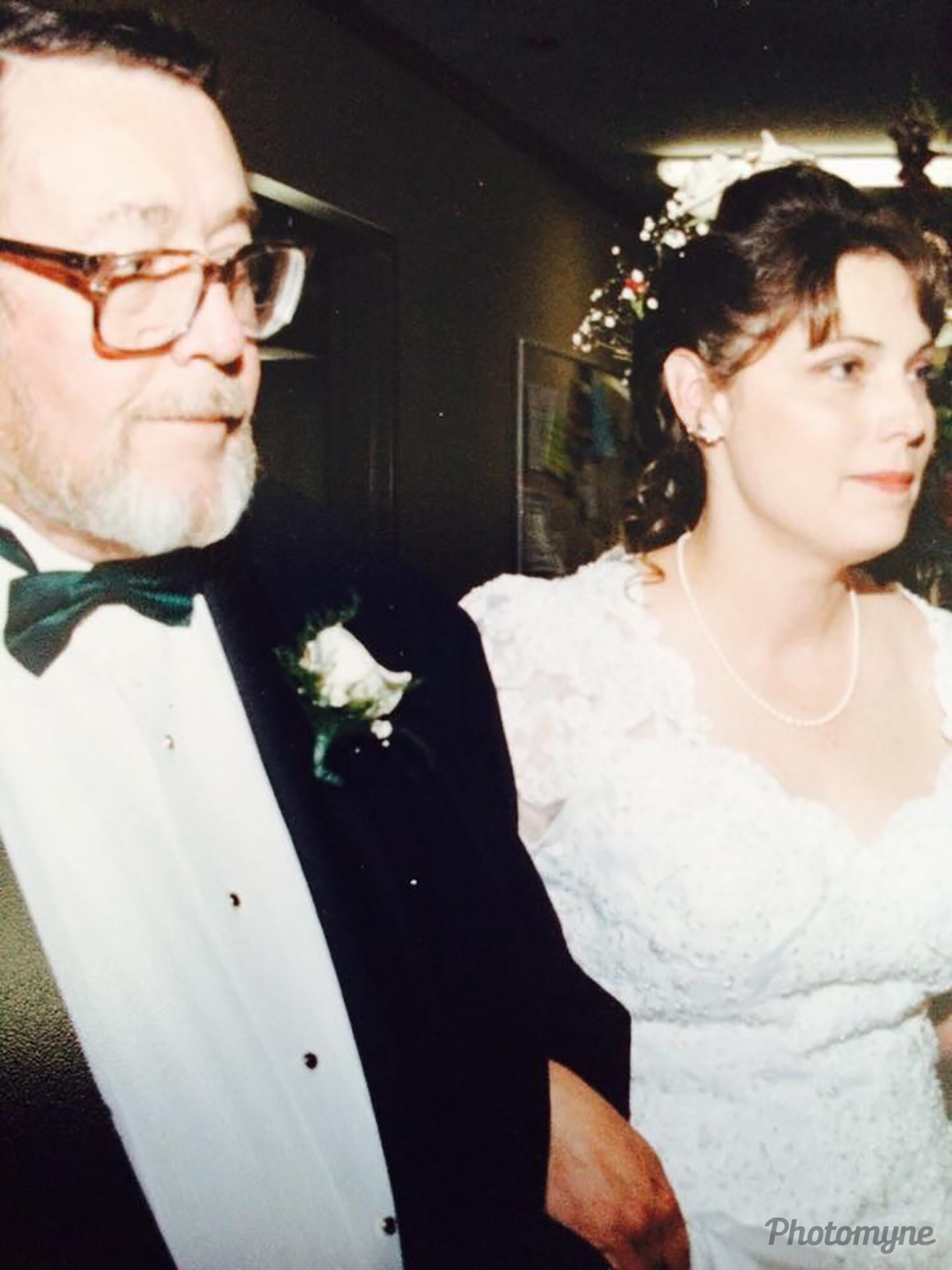 This is me on my wedding day, holding hands with my father. Such a special day. USA