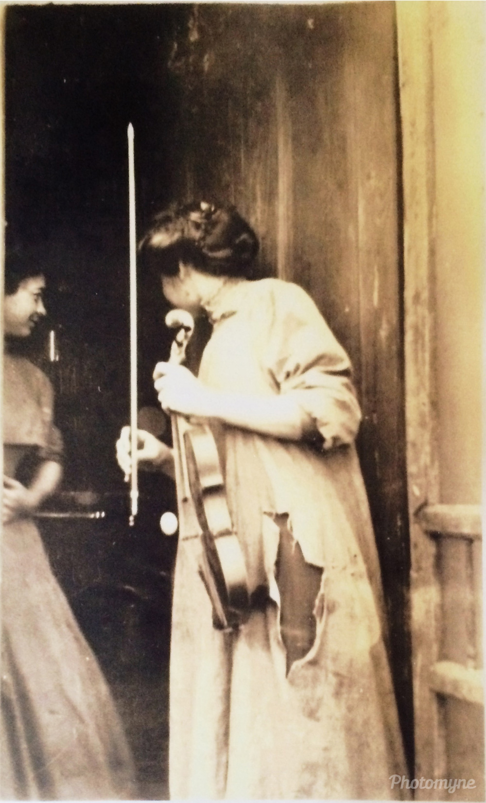 Grandma Georgiana Eldred with her violin and her sister Ruthie looking on, 1910, Glen Elder, Kansas, US